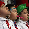 MARIA UMINSKI/GLOUCESTER DAILY TIMES First graders Jayden Toppan, Adam Bazel and Michael Toppan play their Kazoos during the Veterans Memorial Elementary School Holiday Sing-a-Long on Thursday.