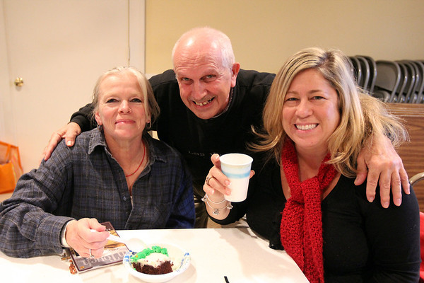 Allegra Boverman/Gloucester Daily Times. The Grace Center, Inc. held a celebration of its first year on Wednesday. From left, enjoying the live music by Keith Allen of Newburyport, are guests Barbara Parsons and George Carr, and volunteer Lisa Summerville of Newburyport.