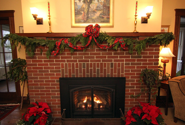 """Allegra Boverman/Gloucester Daily Times. In the front entry of a 1920s-style home in Rockport that will be part of the second SeaShells and Jingle Bells benefit featuring a holiday inn and house tour takes place on Saturday, Dec. 8 from 1p.m. to 5 p.m. featuring 12 homes and inns. Each site will feature a sampling of food or drink.  Proceeds support the Rockport High School DECA program and marketing classes. Tickets are available at: Rockport Inn and Suites at 183 Main St. and ToadHall Bookstore, both in Rockport, or online at<a href=""""http://seashellsandjinglebellsrkpt.blogspot.com/"""">http://seashellsandjinglebellsrkpt.blogspot.com/</a>."""