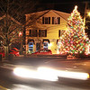 Jim Vaiknoras/Gloucester Times: Downtown Rockport is illuminated by the lights on the Christmas Tree as a car drive by Wednesday night.