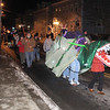 JIm Vaiknoras/Gloucester Times: Jon Holland and Dragon Company lead the Drum Jam Parade up Broadway during New Years Rockport Eve.
