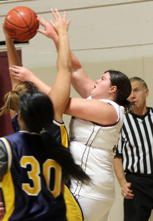 Allegra Boverman/Gloucester Daily Times. Rockport's Kayla Parisi, right, in action against Greater Lowell Tech players, including Samantha Som, lower left, during their game in Rockport on Tuesday. Rockport lost 42-16.