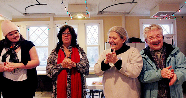 Allegra Boverman/Gloucester Daily Times. The Grace Center,  Inc. held a celebration of its first year on Wednesday. From left, singing and clapping to live music by Keith Allan of Newburyport are: guest Jennifer Burke and volunteers Anita Pandolfe Ruchman, Ann Straccia and Cecily Merrell.