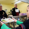 "Allegra Boverman/Gloucester Daily Times. The Rockport Police Department served lunch to Rockport Elementary School students on Thursday, the second year they have done so. Leftovers from the lunch, which included turkey, stuffing, mashed potatoes, gravy, cranberry sauce, string beans and rolls, were brought to the Action homeless shelter in Gloucester immediately following. Chief John ""Tom"" McCarthy and Lt. Mark Schmink serve Austin Matus, a fourth grader."