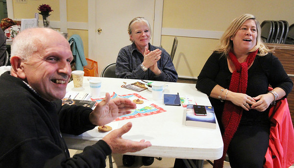 Allegra Boverman/Gloucester Daily Times. The Grace Center, Inc. held a celebration of its first year on Wednesday. From left, enjoying the live music by Keith Allen of Newburyport, are guests George Carr, Barbara Parsons and volunteer Lisa Summerville of Newburyport.