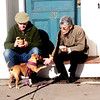 Jim Vaiknoras/Gloucester Times:Gary and barbara Wolfrom enjoy coffee and treats with their dog Dobby on Beach Street in Rockport on a warm Monday afternoon.