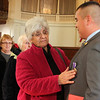 Allegra Boverman/Gloucester Daily Times. Adam Curcuru, right, of Gloucester received a Purple Heart medal on Friday for his injury during his service as a lead gunner in the Third Battalion Sixth Marines in Afghanistan. His grandmother, Grace Curcuru touches his medal after she hugged him after the ceremony.