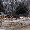Allegra Boverman/Gloucester Daily Times. A Manchester DPW front end loader puts one of the beaches on Ocean Street back to rights after the rainstorm on Thursday caused erosion and damage.