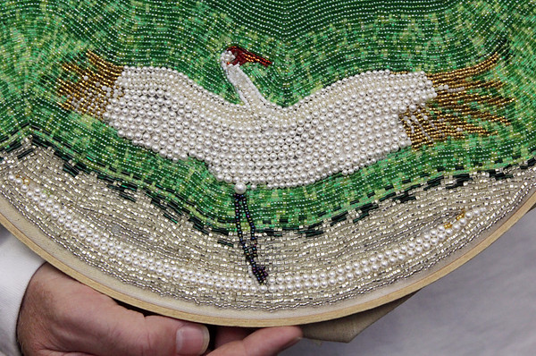 Allegra Boverman/Gloucester Daily Times. Bruce Ware, who recently moved to Gloucester, is displaying some of his intricate beadwork at Sawyer Free Library. This is a detail of a larger piece depicting cranes in flight.