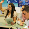 Allegra Boverman/Gloucester Daily Times. From left, Manchester-Essex Regional High School students Teak Switzer, Ellie Mortillaro and Ely Koufman were using iPads in their Business Management class on Tuesday during a unit on ethics.