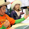 Allegra Boverman/Gloucester Daily Times. It was Crazy Hat Day at the Gloucester Community Arts Charter School on Friday. Daniel Haserlat, left, and Alexis Grammas work on their math while wearing their hats of choice.