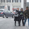 Desi Smith Staff photo/Gloucester Daily Times. From left, Katie Seidman, Laura Harrington and David Rosen take part in the Middle Street Walk on Saturday morning as they all head to the Art Room for showing. December 14,2013