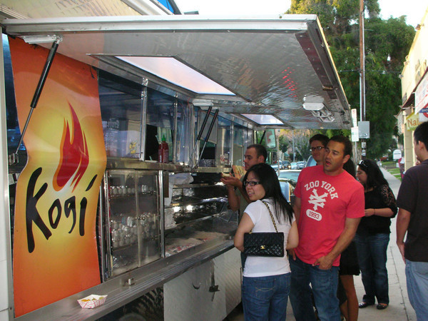 Shery Main/Wikimedia<br /> Diners line up to order at chef Roy Choi's Kogi food truck.
