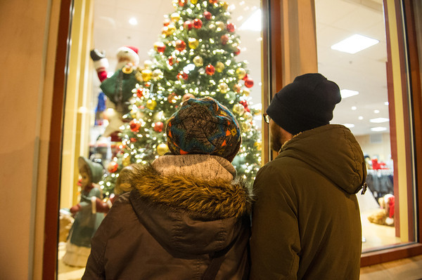 Desi Smith Staff photo/Gloucester Daily Times.  Bronwen Gail and her boyfriend Casey Watson both from Pennsylvania do some window shopping Thursday night as they walked along Main Street during Family and Friends Night. Stores stayed open late with most offering discounts or specials. December 12,2013