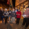Desi Smith Staff photo/Gloucester Daily Times.  Carol's Caroler's sing in front and then inside Kid's Unlimited on Main Street Thursay night during Family and Friends Night. Stores stayed open late with most offering discounts or specials. Singers from left to right are Gardner Winchester, Martha Bowen, Tony Hilliard, Tim Perkins, Carol Karlson and Alexander Thompson.  December 12,2013