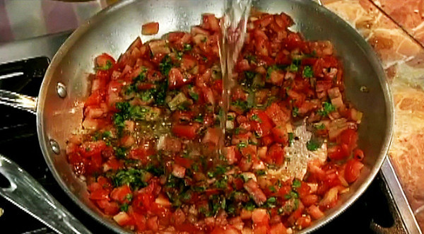 MPN/Courtesy photo<br /> Shrimp, tomatoes, and wine are cooked until the shellfish are opaque and just cooked through.