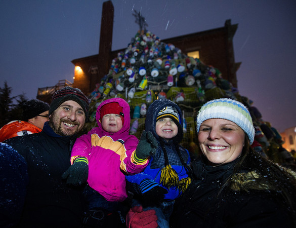 Desi Smith Staff photo/Gloucester Daily Times. Marco and Katie Numerosi of Gloucester and their children, Bianca 20 months and Jacoby 3, eagerly wait for santa and the lighting of the Lobster Trap Tree at the annual lighting Saturday night at the Gloucester Police Station on Main Street.