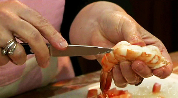 MPN/Courtesy photo<br /> The first step to making Gamberoni all'Amalfitana is clean the shrimp by removing the heads, outer shell and intestinal track.