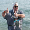 "Desi Smith Staff photo/Gloucester Daily Times.    Rick Doucette gives to thumbs up as he  heads out of the fridged water at Long Beach for ""Freezin' For a Reason"" polar plunge hosted by Gloucester Rotary as a benefit in fight against polio Saturday morning.  February 1,2013."