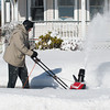 Desi Smith /Gloucester Daily Times.   Roy Warrington of Gloucester uses his electric snow blower to clear the sidewalk in front of his home on Kent Circle Sunday morning. Saturday nights storm dropped about half the amount predicted.   February 16,2014.