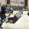 Desi Smith Staff photo/Gloucester Daily Times. Rockport's Kyle Nelson takes a big hit from Swampscott's Griffin Hunt in the second period Saturday night at the Dorothy Talbot Rink.   February 1,2014.