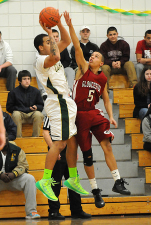 PAUL BILODEAU/Staff photo<br /> <br /> The Fishermen's Austin Davis looks to block the Rams' Monte Wolfe during Gloucester boy's basketball game against Lynn Classical during the Div. 2 North basketball tournament game at Lynn Classical High School.