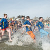 "Desi Smith Staff photo/Gloucester Daily Times.   Gloucester Interact, a  Gloucester High School rotarian team, heads into the fridged water at Long Beach for ""Freezin' For a Reason"" polar plunge hosted by Gloucester Rotary as a benefit in fight against polio Saturday morning.  February 1,2013."