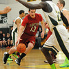 PAUL BILODEAU/Staff photo<br /> <br /> The Fishermen's Connor Adkins drives through the paint for two during Gloucester boy's basketball game against Lynn Classical during the Div. 2 North basketball tournament game at Lynn Classical High School.