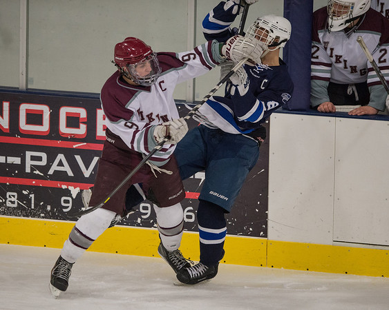 Desi Smith Staff photo/Gloucester Daily Times. Rockport's Jonathan Ferrante puts a hit on Swampscott's Griffin Hunt in the second period Saturday night at the Dorothy Talbot Rink.   February 1,2014.