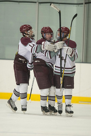 Desi Smith Staff photo/Gloucester Daily Times. Rockport's Alex Rollins (left) and Anthony Lange (right) celebrate Jake O'Maley's goal in the first period against Swampscott Saturday night at the Dorothy Talbot Rink.   February 1,2014.