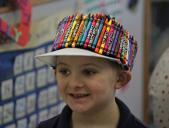 MIKE SPRINGER/Gloucester Daily Times<br /> Kindergartener Zachary Nelson wears a hat decorated with 100 crayons Friday in celebration of the 100th day of school at Veterans Memorial School in Gloucester.
