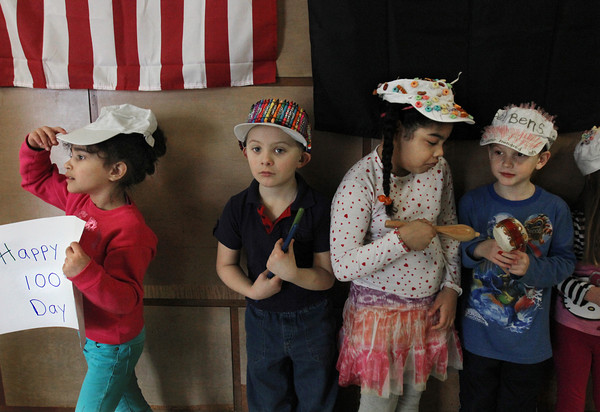 MIKE SPRINGER/Gloucester Daily Times<br /> Kindergarteners, from left, Natasha de Paula, Zachary Nelson, Marlenny Tejada and Ben Sperry wait before the start of a 100th-day parade through the hallways and classrooms of Veterans Memorial School on Friday.