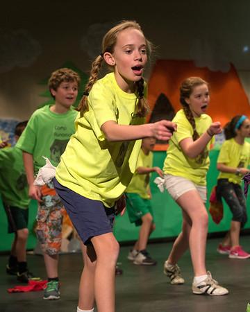 "Desi Smith /Gloucester Daily Times.  5th grader Lilly Coote and others run through their final rehearsal Wednesday afternnon at Manchester Memorial Elementary School. The fifth grade class will perform three shows of ""Summer Camp"" a musical caper about finding a place to belong, starting Thursday February 27 at 4pm, Friday the 28th and Saturday March 1st at 7pm all at the Manchester Memorial Elementary School. <br />   February 26,2014."
