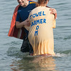 "Desi Smith Staff photo/Gloucester Daily Times.    Marc Hoffener of Cambridge recevied a towel from Amy Luckiewicz of Wakefeild as he  heads out of the fridged water at Long Beach for ""Freezin' For a Reason"" polar plunge hosted by Gloucester Rotary as a benefit in fight against polio Saturday morning.  February 1,2013."