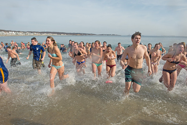 """Desi Smith Staff photo/Gloucester Daily Times.   A group plungers head out of the fridged water at Long Beach for """"Freezin' For a Reason"""" polar plunge hosted by Gloucester Rotary as a benefit in fight against polio Saturday morning.  February 1,2013."""
