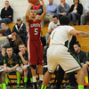 PAUL BILODEAU/Staff photo<br /> <br /> The Fishermen's Austin Davis shoots and hits a three during Gloucester boy's basketball game against Lynn Classical during the Div. 2 North basketball tournament game at Lynn Classical High School.