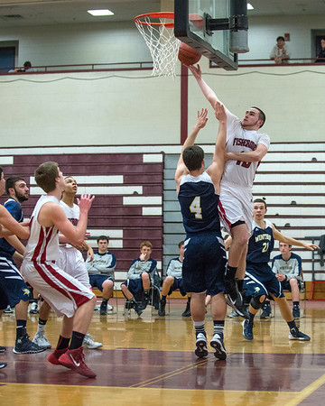 Desi Smith Staff photo/Gloucester Daily Times.    Gloucester's Connor Adkins lays one up against Winthrop Friday night at the Benjamin A Smith Fieldhouse.   January 31,2013.