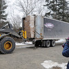 PAUL BILODEAU/Staff photo<br /> <br /> Betsy Brown, left,  of the Manchester Curbside Compost Committee takes a picture as DPW workers unload 2500 composting bins at the old Water Department plant near the high school yesterday.