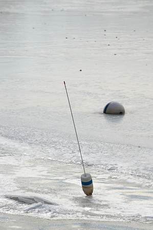 Desi Smith Staff photo/Gloucester Daily Times.    A boat mooring is frozen in the ice in Manchester Harbor Friday afternoon.   January 31,2013.