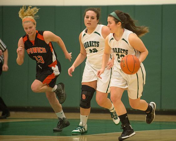 Desi Smith /Gloucester Daily Times.   Manchester Essex's Sydney Christopher moves the ball up court against Ipswich Tigers, followed by her teammate Caitlin Malloy Tuesday night at MERHS.<br />   February 25,2014.
