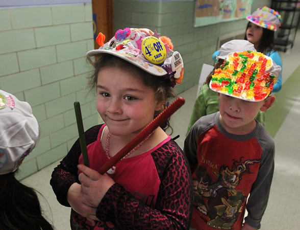 MIKE SPRINGER/Gloucester Daily Times<br /> Kindergarteners Eva Myers and Logan Gaipo are lined up and ready to celebrate the 100th day of school Friday with a parade through Veterans Memorial School.