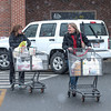 Desi Smith /Gloucester Daily Times.    Friends Amy Larsen (left) and Lisa Bouchard both of Rockport, chat it up after picking up some items at Market Basket Saturday afternoon prepairing for the storm, that never really happened. February 15,2014.
