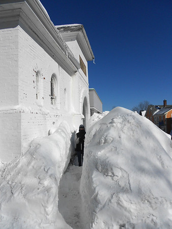 GAIL McCarthy/Staff photo/2/16/15<br />   Narrow walkways appeared on Rockport's Main Street. Here is one carved out of a gigantic snow drift in front of the former Christian Science reading room.