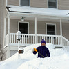 GAIL McCARTHY/Staff photo 2/15/15<br />        Catherine McNiff of Rockport shovels the walkway of her neighbor's house. There was a lot of neighborly help taking place among many of the residents of Twin Light Circle.