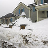 GAIL McCarthy/Staff photo<br />   The snow drifts throughout Cape Ann at times have a sculptured effect.  This house stands at the corner of Beach and King streets in Rockport.