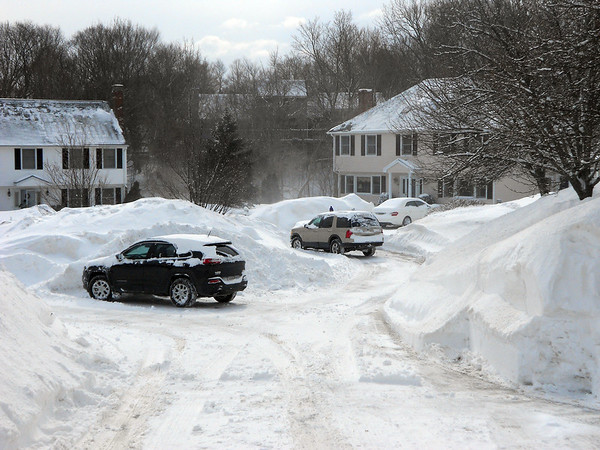 GAIL McCarthy/Staff photo<br />         On Rockport's Twin Light /circle, neighbors move their cars out of driveways to clear the snow, which after the second storm it became nearly impossible to find a place for the new snowfall.
