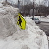 "GAIL McCarthy/Staff photo<br />   One of the pedestrian figures on the pedestrian crossing sign has ""walked"" into the six-foot high snow bank at the entrance to the Rockport transfer station and parking lot."
