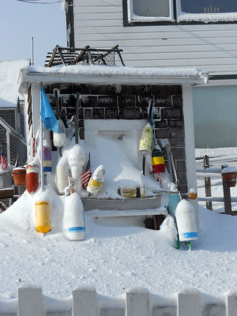 GAIL McCarthy/Staff photo 2/15/15<br /> This shack on Bearskin Neck sports a collection of lobster buoys that lend color to the prolific snowfall.