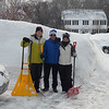 GAIL McCarthy/Staff photo<br /> From left are neighbors Conor Douglass, Jules Boudreau and Emily Douglass taking a break from shoveling after one of the many storms this winter of 2015.