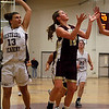 Gloucester's Olivia Lufkin leaps for a shot as Westport Academy's Emily Babon tries to catch up to her during the first round of the Division II North State Tournament at Westford Academy last night. Photo by Kate Glass/Gloucester Daily Times Monday, February 23, 2009